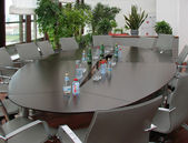 Oval table for negotiations in the offic — Stock Photo