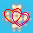 Hearts over halftone background — Stock Vector