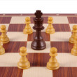 King surrounded by pawns on chess board — Stock Photo