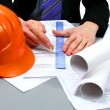 Stock Photo: Architect working with technical drawing