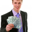 The businessman holds money — Stock Photo #1223076