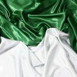 Royalty-Free Stock Photo: Smooth elegant green and white silk can use as background
