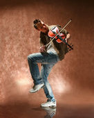 The young man with a violin — Stock Photo