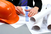 Architect working with technical drawing — Stock Photo