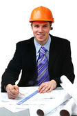 Architect working with technical drawings — Stock Photo