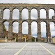 Antique aqueduct  in cloudy day — Stock Photo