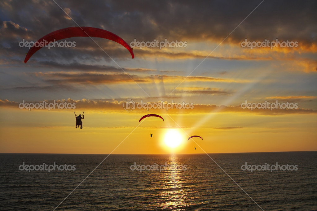 Operated parachutes above the sea on a sunset  Stock Photo #1218320