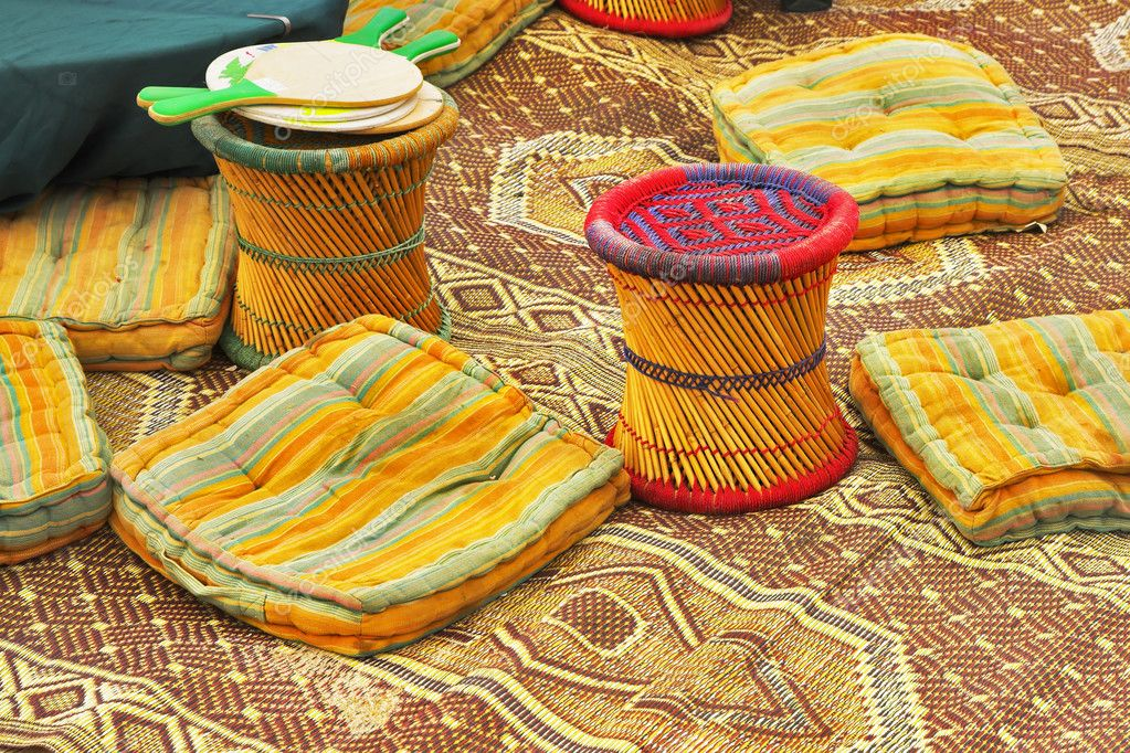 Utensils in ancient authentic bedouin tent - carpets, pillows and padded stools — Stock Photo #2604641
