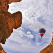 The balloon flies above canyon — Stock Photo #2616522