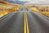 The American road and fencings — Stock Photo