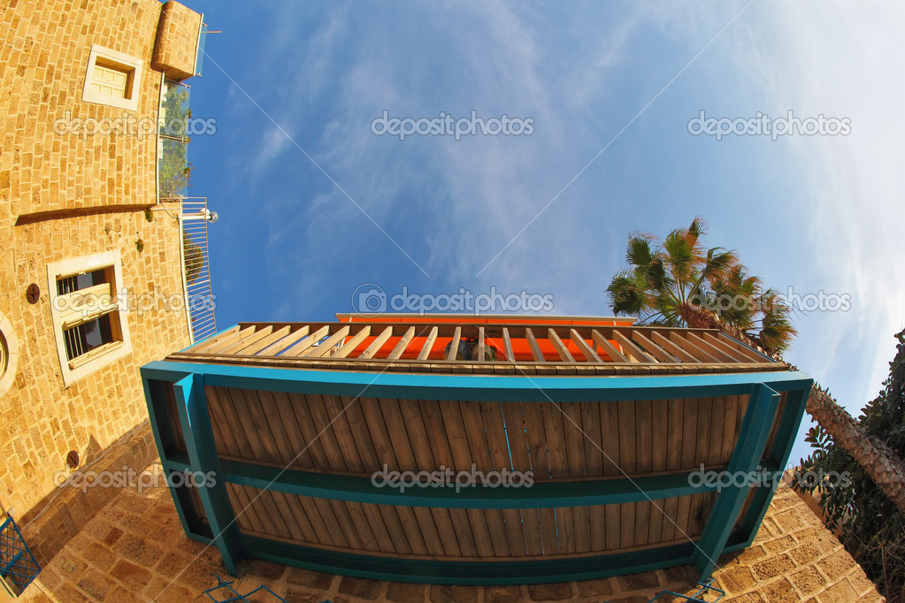 """Balcony and window of the ancient house, in lens """"fish eye"""" ."""
