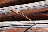 Bayonet in wall of the wooden building — Stock Photo