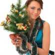 Girl with the new-year tree. — Stock Photo