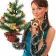 Girl with a new-year tree and tiger cub. — Stock Photo