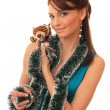 Beautiful girl with a toy tiger cub. — Stock Photo