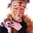 Girl a tiger with a toy tiger cub. — Photo