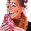 Stock Photo: Girl tiger with piece of raw meat.