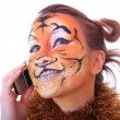 Stock Photo: Girl tiger speaks on mobile telephone