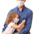 Family in medical masks with a thermomet — Stock Photo #1232447