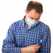 Man in a medical mask with a thermometer — Stock Photo #1232740