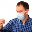 Man in medical mask with a thermometer. — Stock Photo