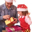 Dad with daughter open gifts. — Stock Photo #1232971