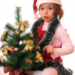 Girl with new-year tree. - Stock Photo