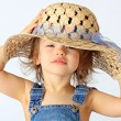 Stock Photo: A girl is in a hat.