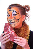 Girl tiger with the piece of raw meat. — Stock Photo