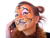 Girl tiger speaks on a mobile telephone — Stock Photo