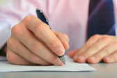 Hand with a pen. — Stockfoto
