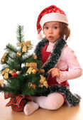 Girl with new-year tree. — Stock Photo