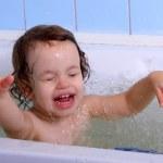A little girl bathes. — Stock Photo