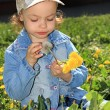 Little girl with dandelions. — 图库照片 #1246920