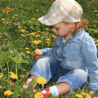 Little girl with dandelions. — Stock Photo