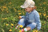 Little girl with dandelions. — Stock Photo