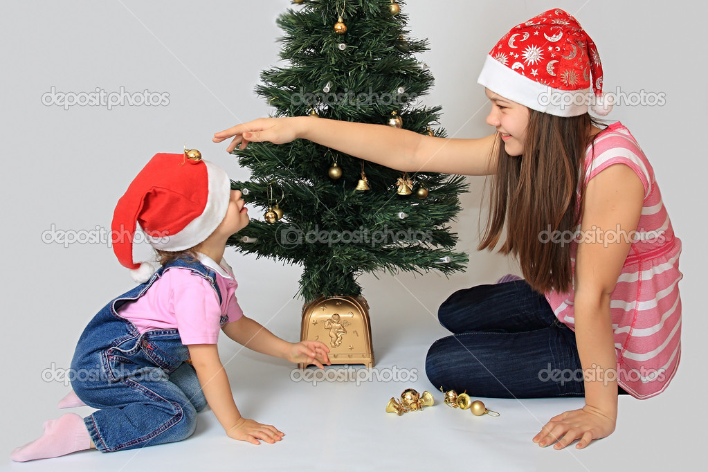 A sisters in the cap of Santa Claus. — Stock Photo #1246356