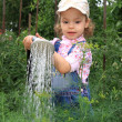 Girl pours a vegetable garden. — Стоковое фото #1250230