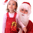 Santa Claus and dwarf with a gift. - Stock Photo