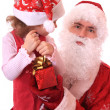 Stock Photo: Santa Claus and dwarf with a gift.