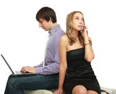 Fellow and girl. Different interests. — Stock Photo