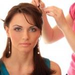 Stylist makes hair beautiful girl. — Stock Photo