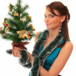 Beautiful girl with new-year tree. — Stock Photo