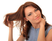 Beautiful girl straightens her hair — Stock Photo