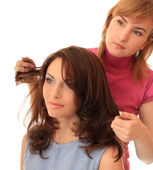Stylist makes hair — Stock Photo
