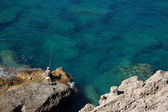 Fisherman On A Rock — Stock Photo