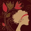 Royalty-Free Stock Vector Image: Beautiful woman silhouette with a flower