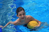 Boy with a waterpolo ball — Stock Photo