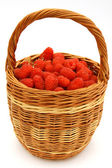 Raspberry in wicker basket — Stock Photo