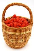 Raspberry in wicker basket — Stock Photo